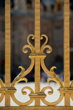Detail of golden door of Versailles Palace. France  photo