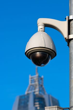 Surveillance Cameras of Office Building Under Blue Sky Stock Photo - 7775359