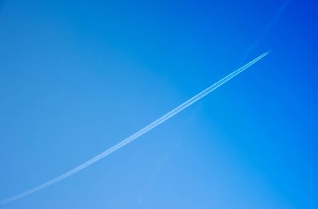 moving images: Closeup of airplane trail in the sky Stock Photo