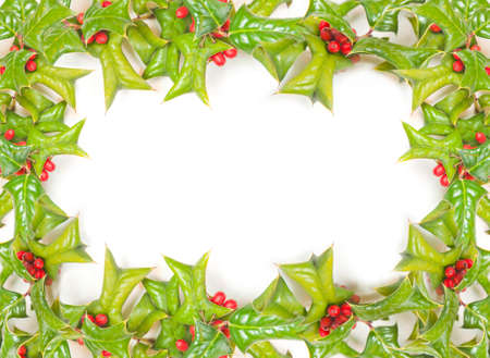 Christmas framework with holly berry isolated photo