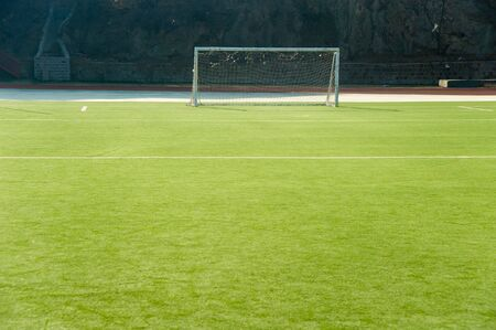 Detail from soccer/football pitch, goal on artificial grass   Stock Photo