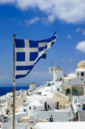 Greece flag on Oia background at Santorini island,Greece