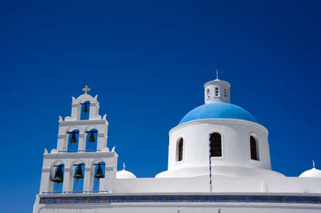 Greek orthodox church in Oia village on Santorini photo