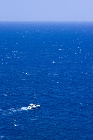 Motor yacht underway out at sea  photo