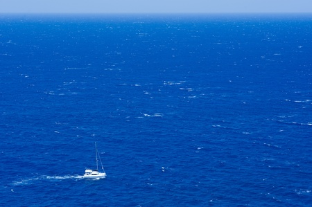 Motor yacht underway out at sea  Stock Photo