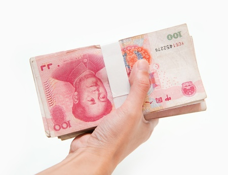 yuan: Thousands china currency one hundred RMB yuan isolated on white  Stock Photo