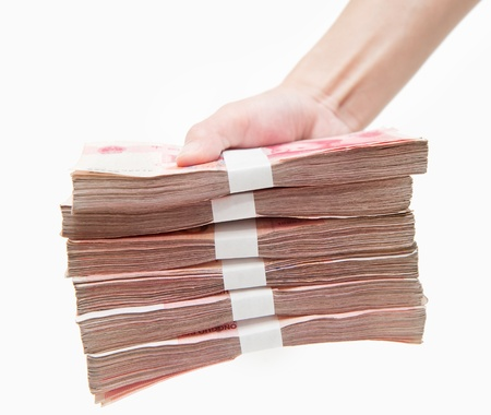 appears: Thousands china currency one hundred RMB yuan isolated on white  Stock Photo