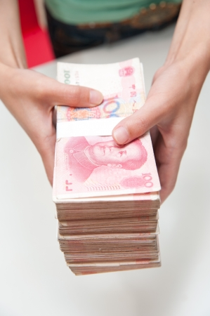 rmb: Thousands china currency one hundred RMB yuan isolated on white  Stock Photo