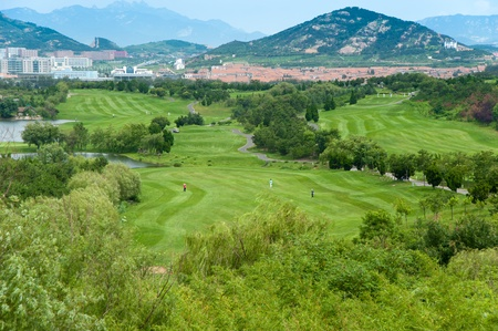 fairway: An aerial view of the fairway and green at a mountain resort golf course