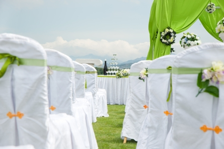 Row of decorated chairs on a outdoor wedding  photo