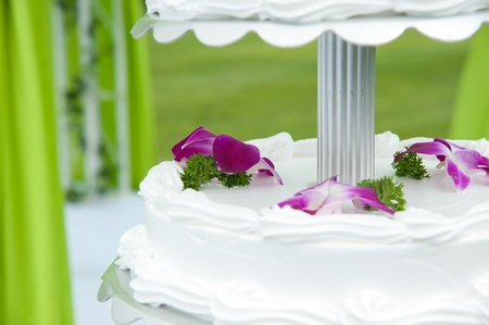 icing sugar: Wedding cake with flower on Stock Photo