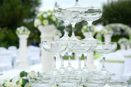 champagne glasses of an outdoor wedding photo