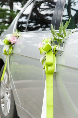 wedding decorated car with bow   Stock Photo