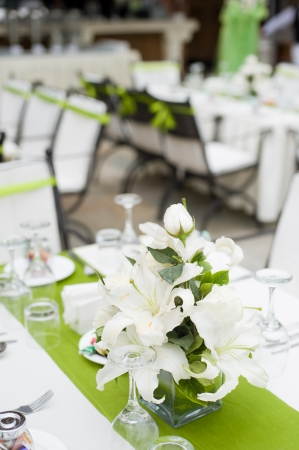 Table setting for a outdoor wedding with flowers photo