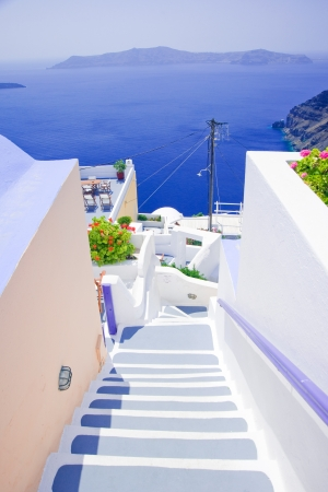 White old staircase and flowers at Santorini island,Greece Stock Photo