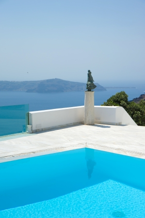 Swimming pool at Santorini island Greece Stock Photo - 16171373
