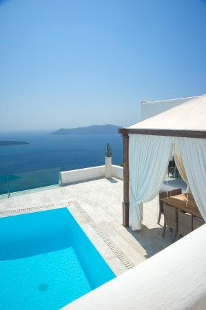 Swimming pool at Santorini island Greece photo