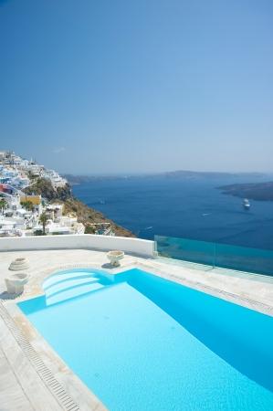 Swimming pool at Santorini island Greece photo
