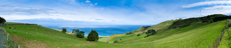Grazing sheep on the meadows with Rustic fence,panorama,Cant erbury,South island, New Zealand Stock Photo