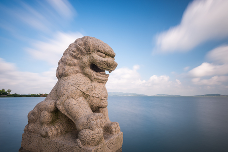 Figurine of lion by the sea