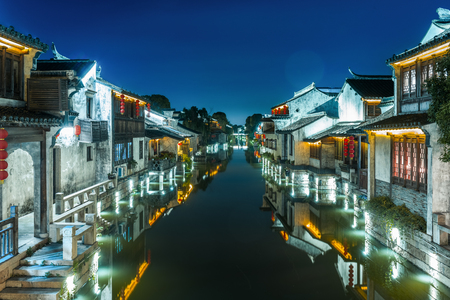 night scene in a town with canal