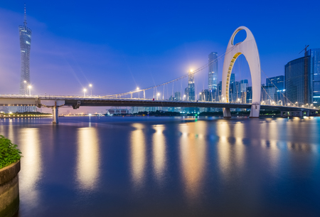 cable stayed bridge over a river at night Stock Photo