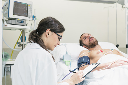 pulsating: Doctor is caring a sick patient in hospital.