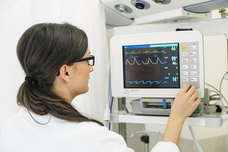 female catheter: Medical doctor making ECG test in hospital. Medical Concept Stock Photo