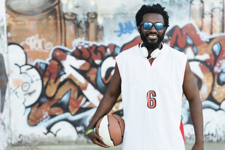 Portrait of Black Man with Casual Sport wear and basket ball.