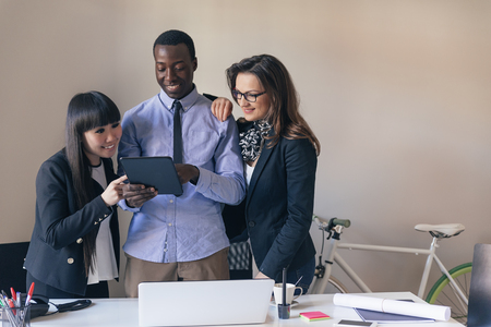 young entrepreneurs: Young Entrepreneurs Working at the Office. Stock Photo