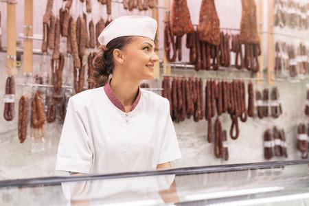 carnicería: Pretty Butchery Woman working in butchery shop.
