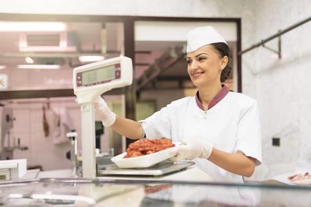 carniceria: Pretty Butchery Woman working in butchery shop.