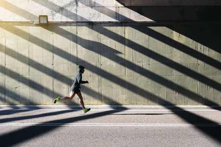 Fitness, workout, sport, lifestyle concept. Man running in the city. Stock Photo
