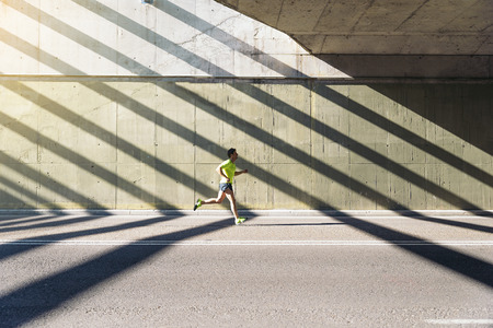 Fitness, workout, sport, lifestyle concept. Man running in the city. Standard-Bild