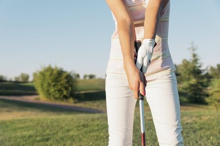 woman golf: Woman golf player concentrating for putting on green. Golf Concept Stock Photo