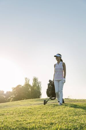 woman golf: Pretty young woman playing golf. Golf Concept. Stock Photo