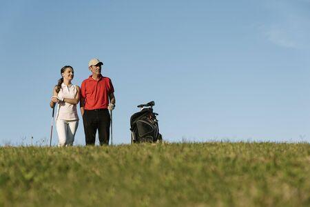 caddie: Golfer and Caddie playing golf. Golf Concept.