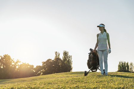 woman golf: Pretty young woman playing golf. Stock Photo