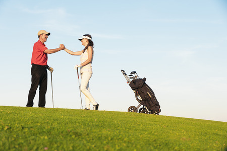 Golfer and Caddie playing golf. Golf Concept.