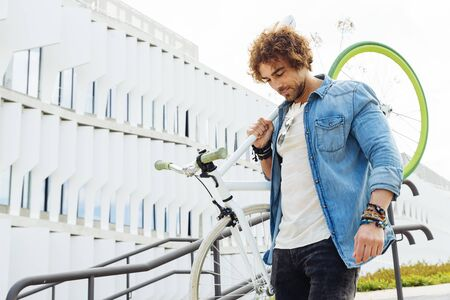 Handsome young man with fixed gear bicycle in the street. Stock Photo