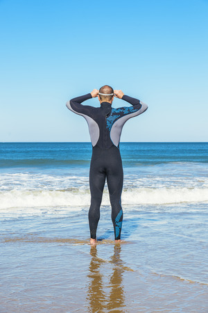 swimmer ready to go swimming in the sea Stock Photo