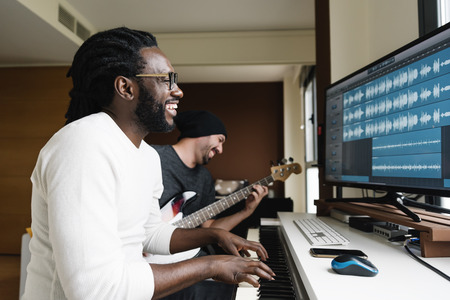 Artists producing music in their home sound studio. Stock Photo - 69284807