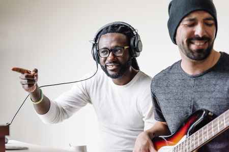 Artists producing music in their home sound studio. Stock Photo - 69278883