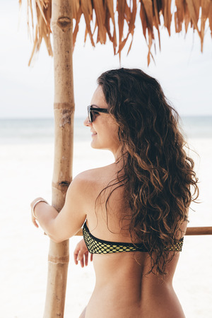 Woman Relaxing On The Beach. Vacation Summer Concept.