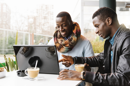 Business men using mobile and laptop in the coffee shop. Business Concept Standard-Bild