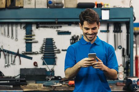 Portrait of Car Mechanic Man in Garage.