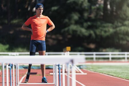 Portrait of disabled man athlete with leg prosthesis.