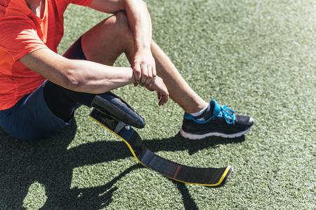 invalidity: Disabled man athlete taking a break Stock Photo