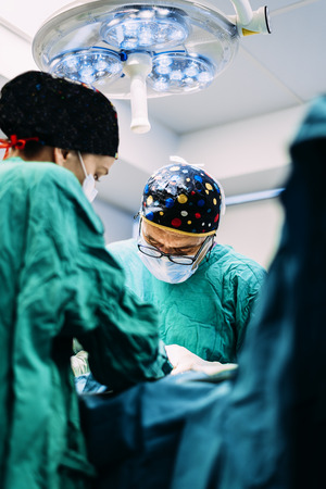 Team of Surgeons Operating in the Hospital. Surgery Concept. Stock Photo