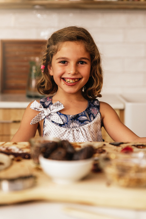 Portrait of little girl preparing baking cookies. Infant Chef Concept.